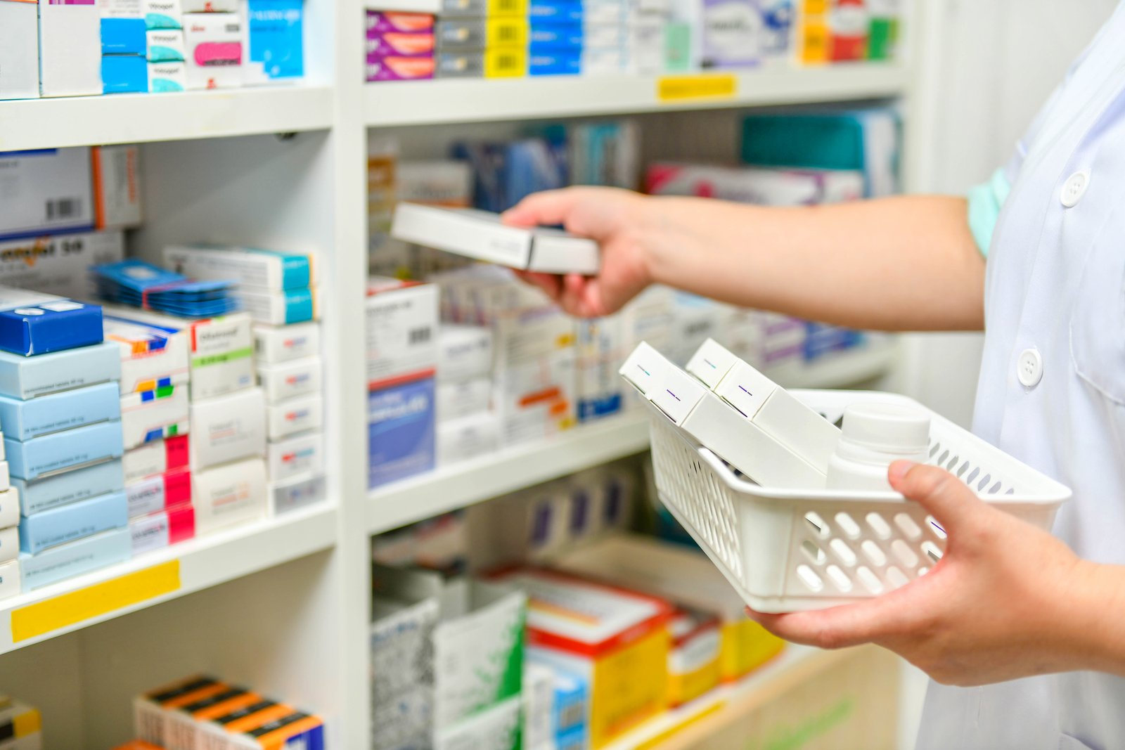 Close Up Pharmacist Filling Prescription In Pharmacy Drugstore